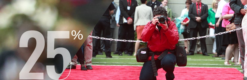 Campus photographer working at commencement